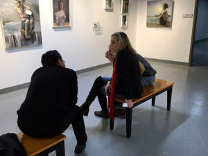 Photo: Looking at art in a gallery.