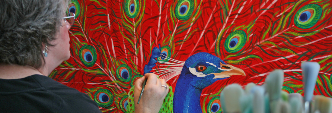 Judith painting a peacock
